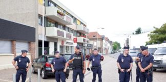 epaselect epa05441779 Police guards the area near to the scene of a hostage taking incident in Saint Etienne du Rouvray, near Rouen, France, 26 July 2016. According to reports, two hostage takers were killed by the police after they took hostages at a church in Saint Etienne du Douvray. One of the hostages, a priest was killed by one of the perpetrators. EPA/JULIEN PAQUIN